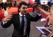 "<p>Actor Emile Hirsch reacts as greets fans during a red carpet for film ""Killer Joe"" at the 68th Venice Film Festival September 8, 2011. REUTERS/Alessandro Bianchi</p>"