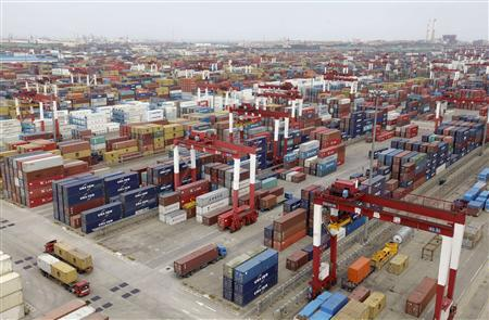 Trucks are driven into a shipping container area at Qingdao port , Shandong province in this September 2, 2011 photo. REUTERS/Stringer