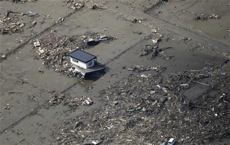 An aerial view of the earthquake and tsunami damage at the coastal town of Minami Soma March 12, 2011. REUTERS/Kim Kyung-Hoon
