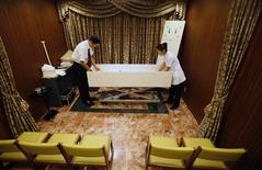<p>Morticians prepare a body at the Lastel corpse hotel in Yokohama, south of Tokyo, September 10, 2011. Death is a rare booming market in stagnant Japan and the Lastel corpse hotel, where bereaved families can check in their dead while they wait their turn in the queue for one of the city's overworked crematoriums, is just one example of how businessmen are trying to tap it. REUTERS/Yuriko Nakao</p>
