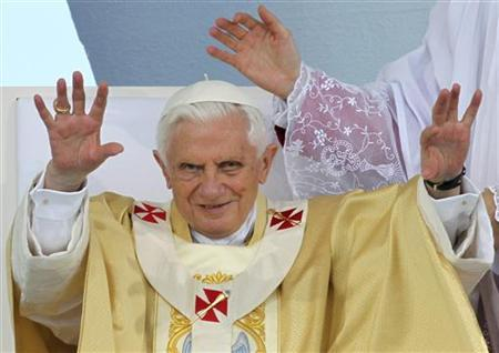 Pope Benedict XVI waves as he arrives to celebrate a Mass in Ancona's shipyard, central Italy September 11, 2011. REUTERS/Giorgio Benvenuti