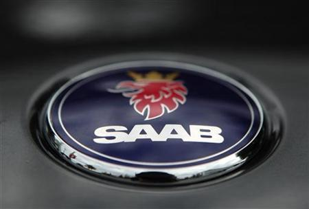 A logo of Swedish car manufacturer Saab is pictured on a car in Vienna, June 24, 2011. REUTERS/Heinz-Peter Bader