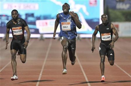 Usain Bolt (C) of Jamaica sprints to win the men's 100 metres event ahead of Trinidad's Richard Thompson (L) and Kim Collins of St Kitts and Nevis at the IAAF grand prix international athletic meet in Zagreb September 13, 2011. REUTERS/Srdjan Zivulovic