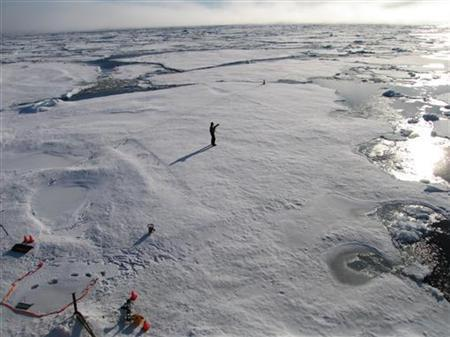 A member of a team of Cambridge scientists trying to find out why Arctic sea ice is melting so fast, walks on some drift ice 500 miles (800 km) from the North Pole September 3, 2011. REUTERS/Stuart McDILL