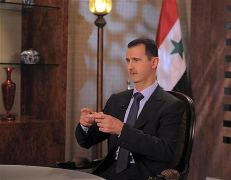 Syria's President Bashar Assad speaks during an interview with Syrian state television in Damascus August 21,2011, in this handout photograph released by Syria's national news agency SANA. REUTERS/Sana/Handout