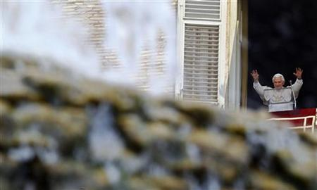 Pope Benedict XVI waves as he arrives to lead the Sunday angelus prayer from the window of his private apartment in Saint Peter's Square at the Vatican July 3, 2011. REUTERS/Max Rossi