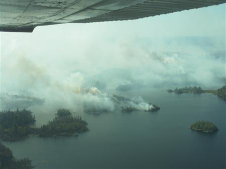 This aerial view of the Pagami Creek Fire burning along lake shore in the Superior National Forest in Minnesota is shown in this photograph posted September 13, 2011 Superior National Forest web site. REUTERS/Superior National Forest/U.S. Forest Service/Handout