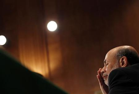 Chairman of the Federal Reserve Ben Bernanke reacts while testifying before the Senate Banking, Housing and Urban Affairs Committee about ''The Semiannual Monetary Policy Report to the Congress'' on Capitol Hill in Washington, July 14, 2011. REUTERS/Larry Downing