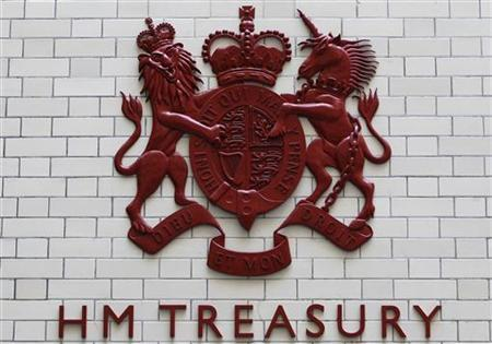 A shield of arms adorns a wall inside the Treasury in central London, October 20, 2010. REUTERS/Alistair Grant/Pool