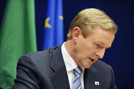 Ireland's Prime Minister Enda Kenny speaks during a news conference at the European Council building at the end of an Euro zone leaders crisis summit in Brussels, July 21, 2011. REUTERS/Eric Vidal
