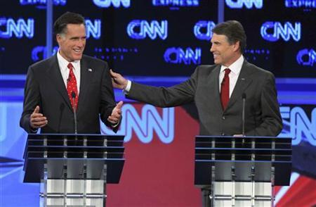 Texas Governor Rick Perry (R) and former Massachusetts Governor Mitt Romney exchange comments during the CNN/Tea Party Republican presidential candidates debate in Tampa, Florida, September 12, 2011. REUTERS/Scott Audette