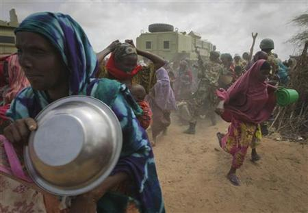 Women rush into a feeding centre in a camp established by the Somali Transitional Federal Government (TFG) for the internally displaced people in Mogadishu July 20, 2011. REUTERS/African Union-United Nations Information Support Team/Stuart Price/Handout