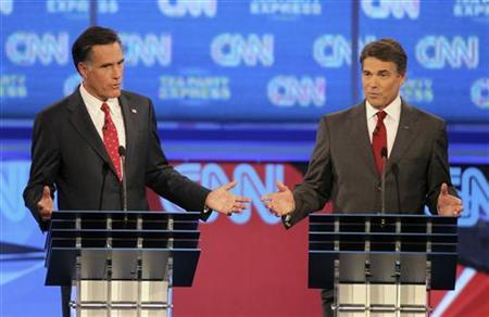 Former Massachusetts Governor Mitt Romney (L) and Texas Governor Rick Perry participate in the CNN/Tea Party Republican presidential candidates debate in Tampa, Florida September 12, 2011. REUTERS/Scott Audette