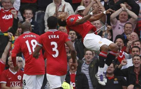 Manchester United's Nani (R) celebrates scoring against Chelsea during their English Premier League soccer match in Manchester, northern England September 18, 2011. REUTERS/Phil Noble
