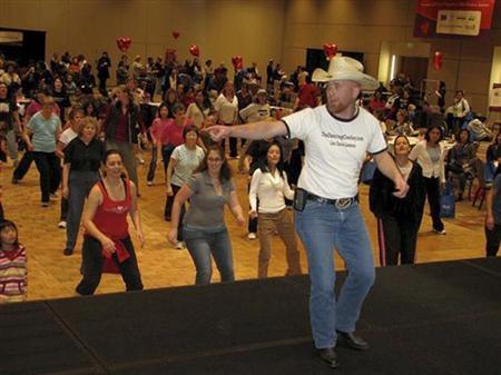 Adam Herbel, a.k.a. the Dancing Cowboy, leads a line dancing session at Santa Clara Convention Center, Santa Clara, California, in this 2010 handout photo. REUTERS/El Camino Day of Dance/Handout