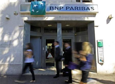 People walk in front of a branch of French BNP Paribas bank in Marseille, September 13, 2011. REUTERS/Jean-Paul Pelissier