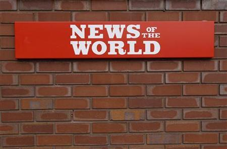 A sign is seen outside the News International Limited complex, in London January 27, 2011. REUTERS/Suzanne Plunkett