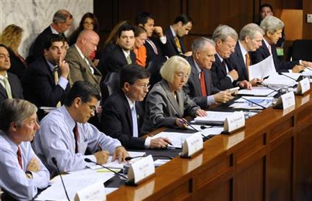 Representative Fred Upton (R-MI) (L-R), Rep. Xavier Bacerra (D-CA), Rep. Jeb Hensarling (R-TX), Senator Patty Murray (D-WA), Sen. Jon Kyl (R-AZ), Sen. Max Baucus (D-MT), Sen. Rob Portman (R-OH) and Sen. John Kerry (D-MA) meet for the first time for a Joint Deficit Reduction Committee hearing on Capitol Hill in Washington, September 13, 2011. REUTERS/Jonathan Ernst