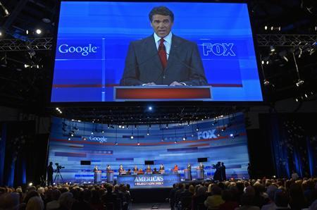 Texas Governor Rick Perry is shown on screen during the Republican Party of Florida presidential candidates debate in Orlando, Florida September 22, 2011. REUTERS/Phelan M. Ebenhack/Pool