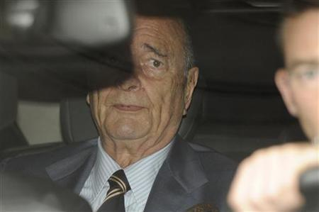 Former France's President Jacques Chirac sits in his car as he leaves his apartment in Paris September 6, 2011. REUTERS/Gonzalo Fuentes