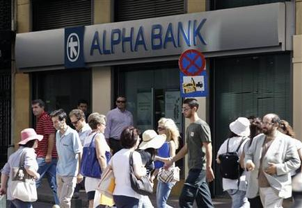 Commuters make their way in front of an Alpha bank branch in Athens September 23, 2011. REUTERS/Yiorgos Karahalis