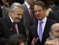<p>U.S. Treasury Secretary Timothy Geithner (R) talks to European Central Bank President Jean-Claude Trichet during a family photo before the International Monetary and Financial Committee (IMFC) meeting during the annual IMF-World Bank meetings in Washington September 24, 2011. REUTERS/Yuri Gripas</p>