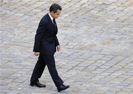 French President Nicolas Sarkozy attends a ceremony commemorating the Harkis, Algerian soldiers loyal to the French during the Algerian war, at the Invalides in Paris, September 25, 2011. REUTERS/Philippe Wojazer