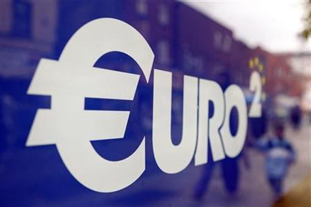 A Euro sign is seen in the window of a discount store on Moore Street in Dublin July 6, 2011. REUTERS/Cathal McNaughton