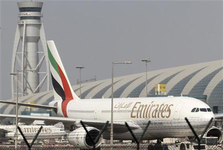Emirates airplanes are seen at the airport in Dubai October 30, 2010. REUTERS/Ahmed Jadallah