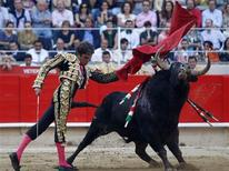 "<p>Spanish bullfighter Jose Tomas performs a pass during the last bullfight at Monumental bullring in central Barcelona September 25, 2011. Fans and opponents of bullfighting crowded into Barcelona on Sunday for the last ""corrida"" to be held in the city's La Monumental arena following a ban on the traditional Spanish spectacle in Catalonia. REUTERS/Albert Gea</p>"