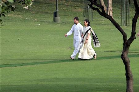 Congress party leader Sonia Gandhi (R) with her son Rahul Gandhi walk at Rajiv Gandhi's memorial on the occasion of the former prime minister's 18th death anniversary in New Delhi May 21, 2009. REUTERS/B Mathur/Files