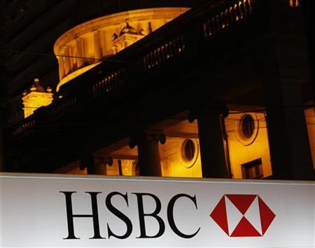 An advertisement of HSBC is displayed outside its headquarters in front of the Legislative Council (background) in Hong Kong September 7, 2011. REUTERS/Bobby Yip