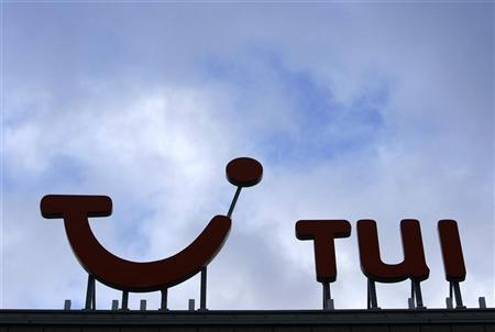 The logo of Germany's TUI AG is pictured on the roof of the TUI AG headquarters in Hanover January 22, 2008. REUTERS/Christian Charisius