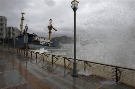 High waves hit the shore as a cargo barge runs aground during Typhoon Nesat in Hong Kong September 29, 2011. REUTERS/Bobby Yip/Files