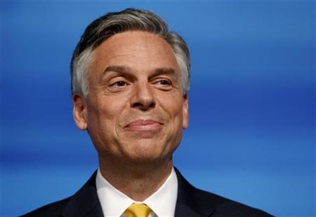 Former U.S. ambassador to China Jon Huntsman smiles before the start of the Republican Party of Florida presidential candidates debate in Orlando, Florida, September 22, 2011. REUTERS/Scott Audette