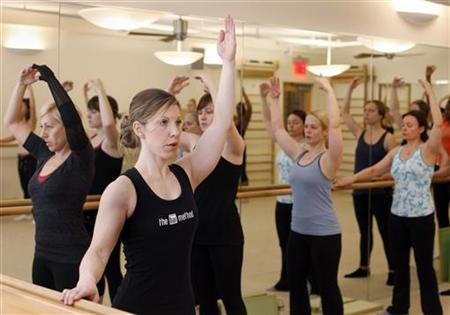 Women participate in exercises during a fitness class at The Bar Method in New York, in this picture taken March 28, 2011. REUTERS/Shannon Stapleton