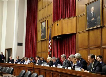 The twelve members of the Congressional Super Committee, six Democrats and six Republicans, gather for opening remarks as the panel holds its inaugural meeting to search for at least $1.2 trillion in new deficit reductions, in Washington, DC, September 8, 2011. REUTERS/Mike Theiler