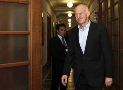 Greece's Prime Minister George Papandreou arrives for a cabinet meeting inside the parliament in Athens October 2, 2011. REUTERS/Panagiotis Tzamaros