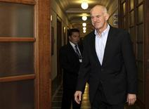 <p>Greece's Prime Minister George Papandreou arrives for a cabinet meeting inside the parliament in Athens October 2, 2011. REUTERS/Panagiotis Tzamaros</p>