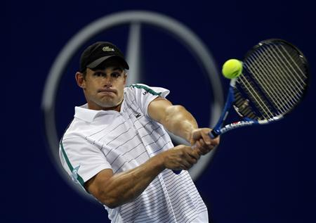 Andy Roddick of the U.S. returns the ball against Kevin Anderson of South Africa during their men's singles match in the China Open tennis tournament at the National Tennis Center in Beijing October 3, 2011. REUTERS/Jason Lee