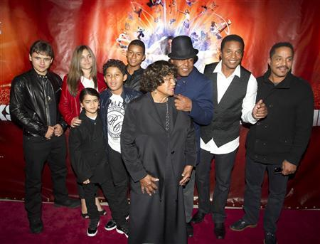 The family of late singer Michael Jackson, including his children Prince Michael Joseph Jackson Jr. (far L) , Paris-Michael Katherine Jackson (2nd L) and Prince Michael Jackson II (L front), his brother's children Jaffar Jackson (3rd L back), Jermajesty (2nd L front) with his mother Katherine (front), and brothers Tito (3rd R), Jackie (2nd R) and Marlon (R) attend the premiere of Michael Jackson THE IMMORTAL World Tour show by Cirque du Soleil in Montreal, October 2, 2011. REUTERS/Christinne Muschi