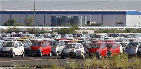 Tata Nano automobiles are seen parked at the carmaker's plant in Sanand, Gujarat, September 26, 2011. REUTERS/Amit Dave/Files