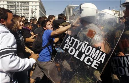 High-school students clash with riot police during a protest march against economic austerity and planned education reforms in Athens October 3, 2011. REUTERS/Yannis Behrakis