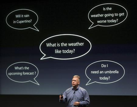 Philip Schiller, Apple's senior vice president of Worldwide Product Marketing, speaks about voice recognition on the iPhone 4S at Apple headquarters in Cupertino, California October 4, 2011. REUTERS/Robert Galbraith