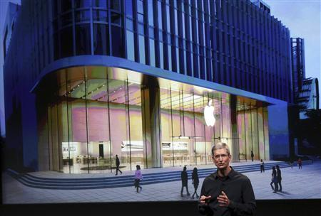 Apple CEO Tim Cook speaks in front of an image of the Shanghai Apple Store at Apple headquarters in Cupertino, California October 4, 2011. REUTERS/Robert Galbraith