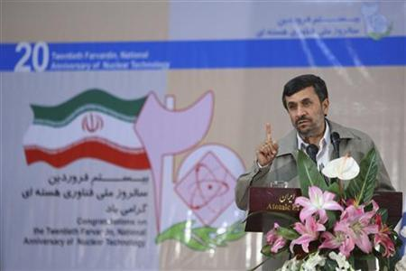 Iranian President Mahmoud Ahmadinejad gestures as he speaks at a ceremony to mark the fifth National Day of Nuclear Technology, in Tehran April 9, 2011. REUTERS/Dolat.ir/Handout