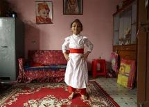 <p>Sambeg Shakya, 6, dances in front of his relatives at his home in Kathmandu September 16, 2011. REUTERS/Navesh Chitrakar</p>