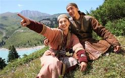 <p>Legendary hero Sartay (R) (Asylkhan Tolepov) sits with his beloved Zere (Aliya Telebarisova) near the Big Almaty Lake in the Tian Shan Mountains where the film Myn Bala was shot in this June 2011 handout photo. REUTERS/New Film Format/Handout</p>