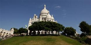 <p>The Sacre Coeur Basilica, one of Paris's tourist attractions, is seen on Montmartre in Paris on August 6, 2009. REUTERS/Benoit Tessier</p>