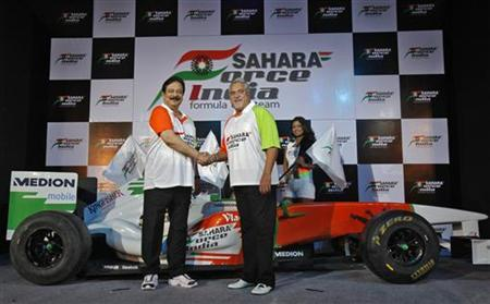 Vijay Mallya (R), co-owner of the Force India Formula One team, and Sahara Group Chairman Subrata Roy shake hands at a news conference in New Delhi October 11, 2011. REUTERS/Adnan Abidi